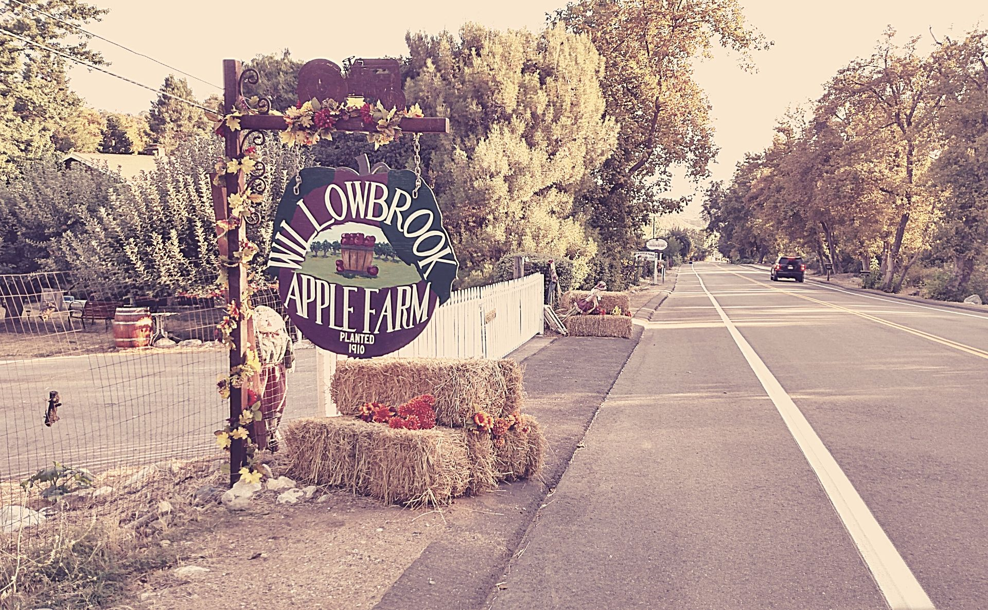 Willowbrook Apple Farm road-side sign above haybales